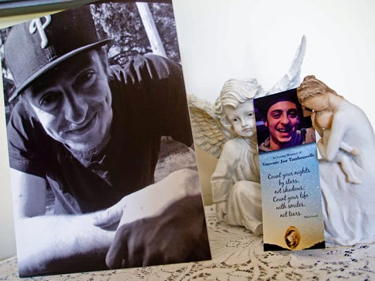 A recent picture and memorial bookmark from 23-year-old