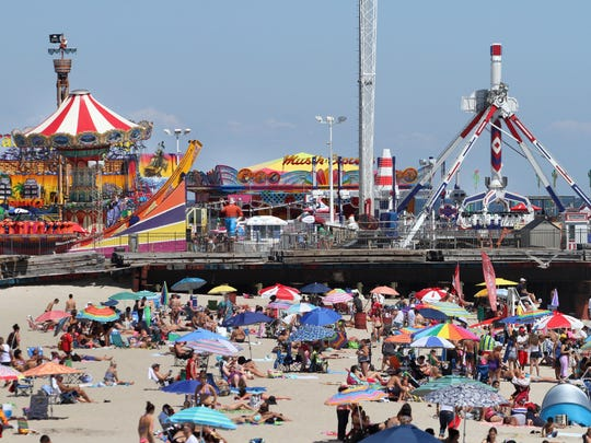 ASB 0825 Seaside Heights  Beach goers soak up the sun on the beach in Seaside Heights, Sunday, August 24, 2014. Mary Frank/Staff Photographer