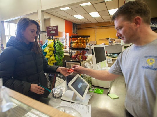 Credit card customers at Myer's Bagel Bakery in Burlington pay using digital payment system.