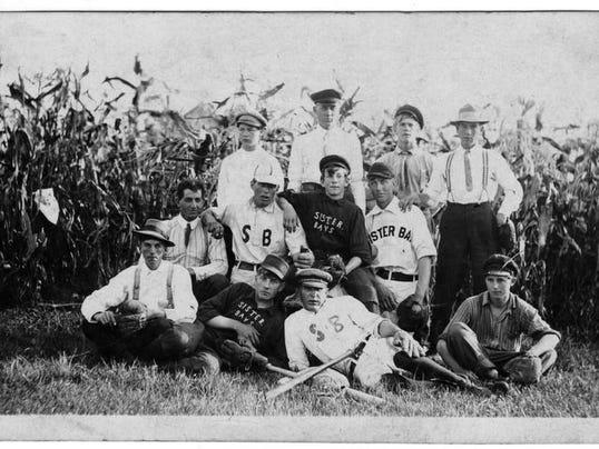 -DCA 0611 Traveling Back Sister Bay Baseball Team.jpg_20140609.jpg