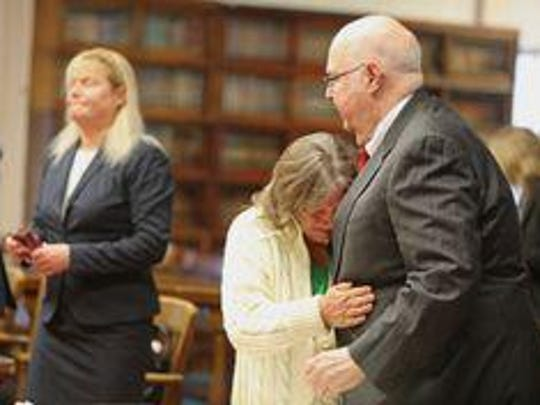 Angela Canepa, who was acting as the prosecutor of those charged with the April 26, 2016, murders of the Rhoden family, is shown here at left in Pike County Common Pleas Court during a Dec. 2 hearing. Rita Newcomb, who pleaded guilty to a misdemeanor charge of obstructing official business, cries into the arms of her attorney, Frank Gerlach. (Dispatch photo by Doral Chenoweth III).