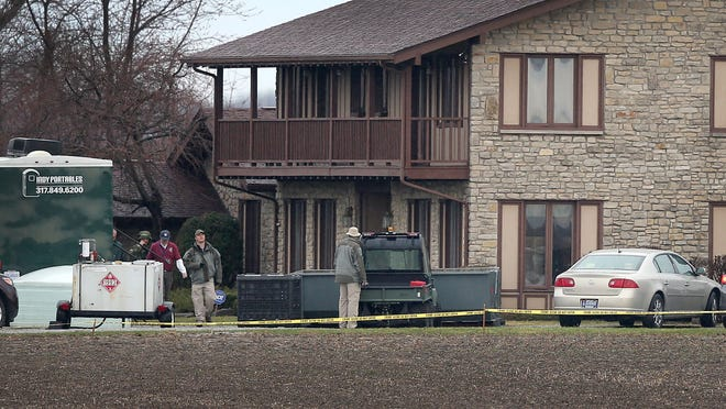 The FBI set up a command vehicle and several tents at the home of Don Miller in the South 8300 block of Rush County Road 850 West near Moscow, Ind., to remove artifacts, on April 2, 2014.
