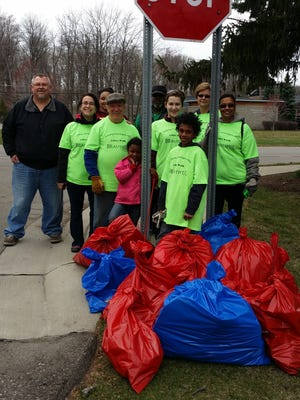 The Franklin Knolls subdivision earned the $75 gift card from Bella Vita Pizzeria for collecting the most trash on Litter Clean-Up Day in Farmington Hills.