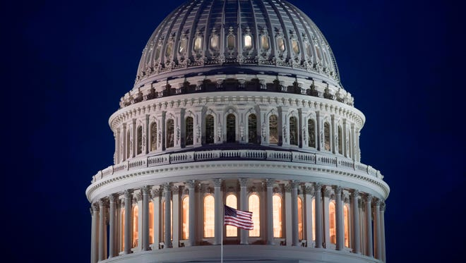 The U.S. Capitol is seen at dusk in Washington on Tuesday.