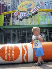William Schmid, of Gardners, plays outside the Crayola Experience attraction in Easton, the birthplace of Crayola crayons.