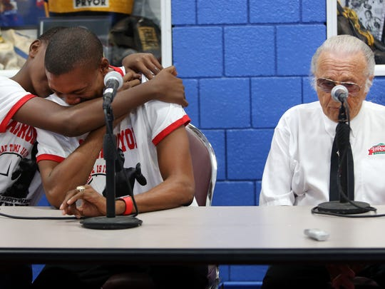 "Aaron Pryor Jr. is comforted by his son, Aaron Pryor III, as he and Buddy LaRosa share memories of Aaron ""The Hawk"" Pryor."