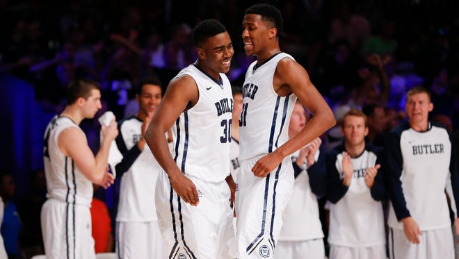 Butler Bulldogs forward Kelan Martin (30) and  forward Kameron Woods (31) react during the game against the North Carolina Tar Heels at Atlantis Resort Imperial Arena.