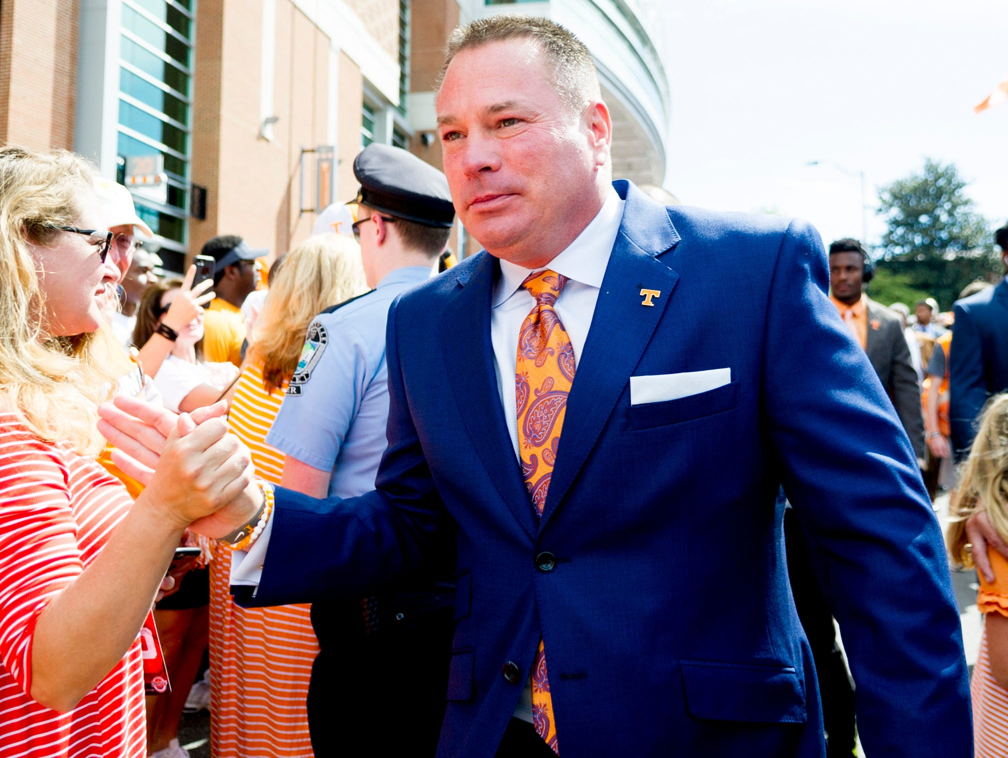 Tennessee Head Coach Butch Jones greets fans during the Vol Walk during the Tennessee Volunteers vs. Georgia Bulldogs game at Neyland Stadium in Knoxville, Tennessee on Saturday, September 30, 2017.