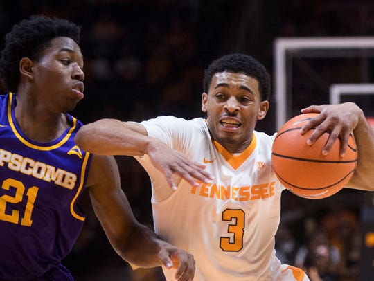 Tennessee guard James Daniel III (3) charges towards