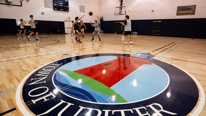 Members of the Jupiter High School freshman basketball team practice inside the Jupiter Community Center gymnasium off of Military Trail on January 7, 2020.
