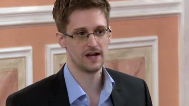 In this image made from video released by WikiLeaks on Friday, Oct. 11, 2013, former National Security Agency systems analyst Edward Snowden speaks during a presentation ceremony for the Sam Adams Award in Moscow, Russia. Snowden was awarded the Sam Adams Award, according to videos released by the organization WikiLeaks. The award ceremony was attended by three previous recipients.