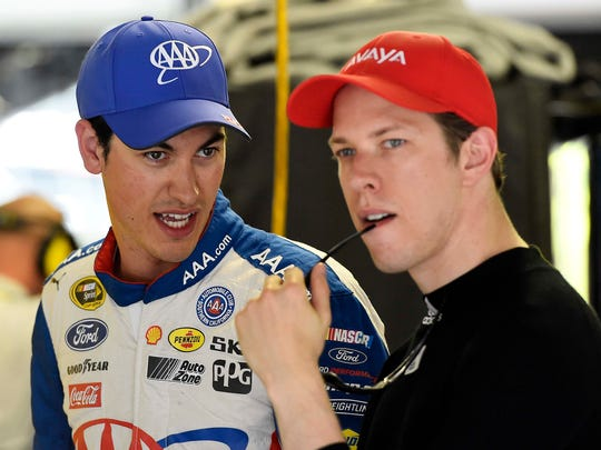 Joey Logano (left) and Team Penske teammate Brad Keselowski