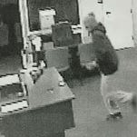Security footage captured the suspect in a bank robbery in Navarre on Friday morning.