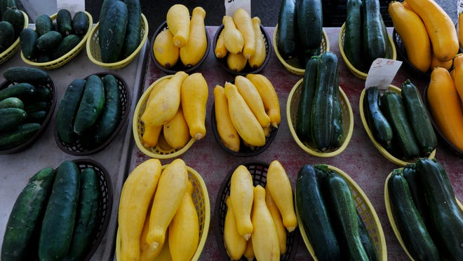 Squash, zucchini and cucumbers rest in baskets for sale Thursday at the Abilene Farmer's Market June 1, 2017.