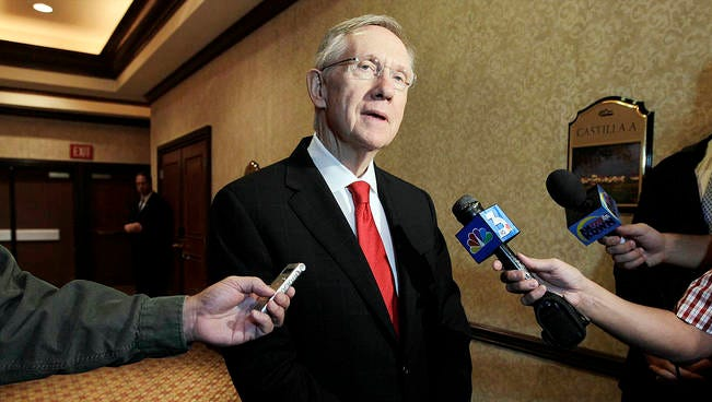 U.S. Sen. Harry Reid answers questions for members of the media after giving a speech at the Air Force Energy Forum on Aug. 25, 2010, in Las Vegas.