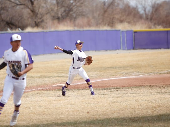 Kirtland Central's Shayne Roanhouse scoops up the ball and throws it to first base for an out against Shiprock during Tuesday's nondistrict game in Kirtland. The Broncos won 3-1. Visit daily-times.com to see more images.