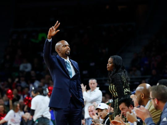 Former Pistons player Richard Hamilton waves to the