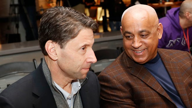 FILE - In this Feb. 7, 2018, file photo, New York Mets owner Jeff Wilpon, left, listens to Mets Special Assistant to the General Manager, Omar Minaya after the Mets introduced their new third baseman, Todd Frazier, during a press conference in New York. With the Mets sinking fast toward the bottom of the National League standings, baseball operations were turned over Tuesday, June 26, 2018, to a trio of Sandy Alderson's assistants when the general manager made the announcement that he was stepping down because his cancer has returned. John Ricco, J.P. Ricciardi and Minaya have decades of front office experience among them, both in New York and elsewhere around the majors.