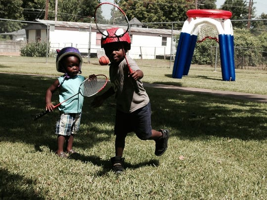 Jadarius (right) and Jamichael Gaines play badminton during a Rec2U program last summer. This summer's Rec2U program begins Tuesday at Harmon Park on Monroe Street and will include fun in a splash pad.