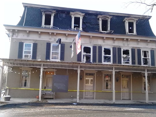 Police tape on the porch prevents entry into the burned out shell of the Kleinfeltersville Hotel on Route 897, just west of Schaefferstown, that was heavily damaged by fire Wednesday morning.