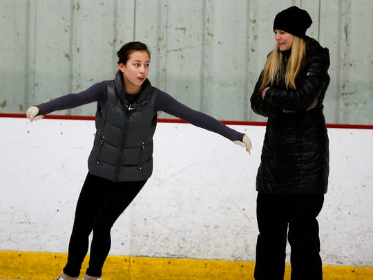 Heidi Hartley, right, figure skating director, works with Cora Scully, 14, at the Northland Ice Center in Evendale Monday March 13, 2017.  The Evendale Fire Department wants the village council to approve an ordinance regulating air quality for indoor ice rinks. The ice rink owners are not opposed to monitoring and measuring carbon monoxide (CO) levels, one of the requirements in the proposed Evendale ordinance. They already do this. They say that they stay within guidelines established by OSHA and the National Institute for Occupational Safety and Health (NIOSH) relating to the indoor operation of equipment, such as forklifts.