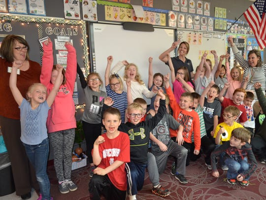 Students in Amy Schlageter's class celebrate after