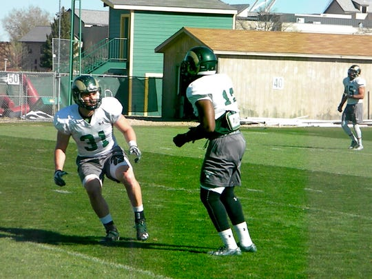 CSU linebacker Max McDonald (31) works on a drill with Trey Sutton during an April 6 practice.