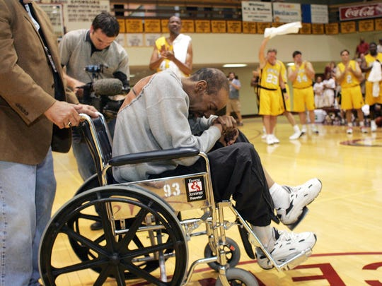 Former Iowa basketball player Kenny Arnold is overcome with emotion as he is honored at halftime of a benefit basketball game in his behalf in 2006.