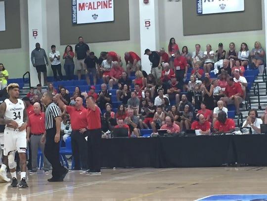 University of Cincinnati fans watch the Bearcats play