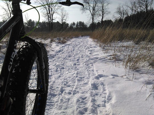 A rider hits the trails at Kettle Moraine State Forest - Lapham Peak Unit. Fat bikes can handle difficult terrain like snow.