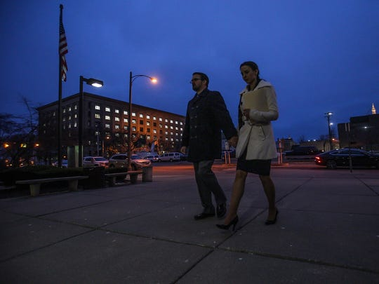 Rachael Denhollander  and her husband, Jacob, walk hand in hand as they prepare to enter the Ingham County Circuit Court at about 7:30 a.m. in Lansing, Mich., Wednesday, Jan. 24, 2018.