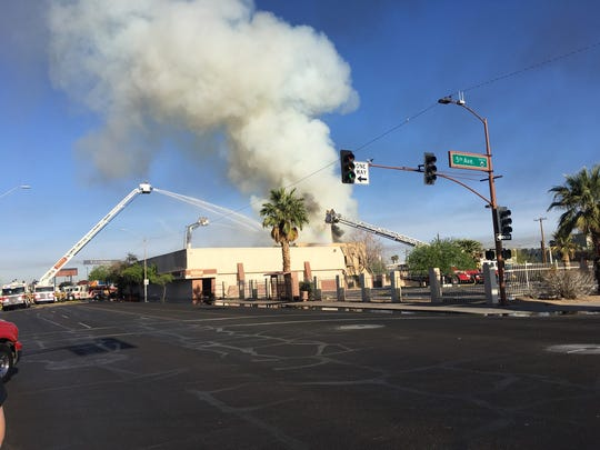 A fire broke out in a vacant building neat 5th Avenue and Van Buren Street in Phoenix on April 19, 2018.
