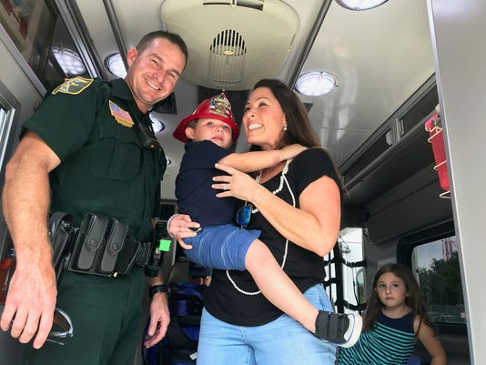 Deputy Hickman, with Dominic and his mother Karla Mancini on the day they reunited. Three years ago, Hickman helped Dominic get to a local hospital fast enough to survive.