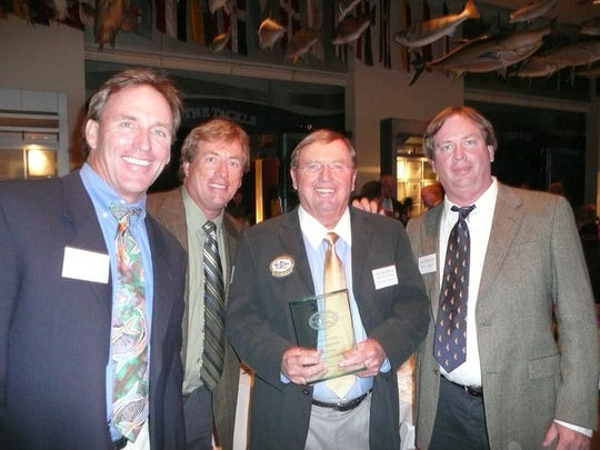 Karl Wickstrom, with sons Blair, Drew and Eric, at Karl's induction unto the IGFA Hall of Fame in 2008.