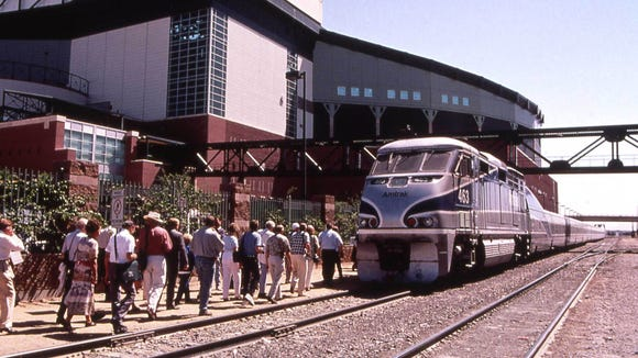 An Amtrak train stops in downtown Phoenix on a 2000 demonstration between the Valley and Tucson. A fast link between the two cities remains elusive.