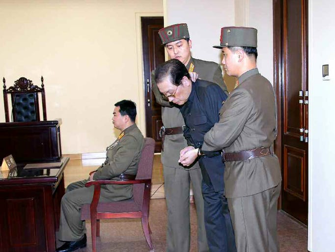 "Jang Song-thaek is escorted in court on December 12, 2013.  North Korea has executed him, the uncle of its leader Kim Jong Un, after a shock purge, state news agency KCNA announced early on Dec. 13, branding the once-powerful man a ""traitor."""