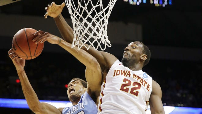 North Carolina's James Michael McAdoo, left, grabs a rebound as Iowa State forward and Lincoln graduate Dustin Hogue fights for the ball during the second half of a third-round game in the NCAA tournament on Sunday.