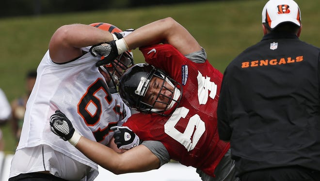 Cincinnati Bengals guard Mike Pollak battles Atlanta Falcons tackle Alec Huynh at the Atlanta Flacons facility during last season's training camp.