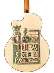 "The ""Lindisfarne Gospels"" guitar from 2009 was decorated by inlay artist Larry Robinson."