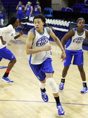 FGCU's Whitney Knight, center, is the top returning player for the Eagles, who will hold their first practice of the 2015-16 season today.