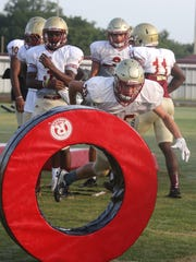 Riverdale's Michael Scruggs (25) works on his tackling