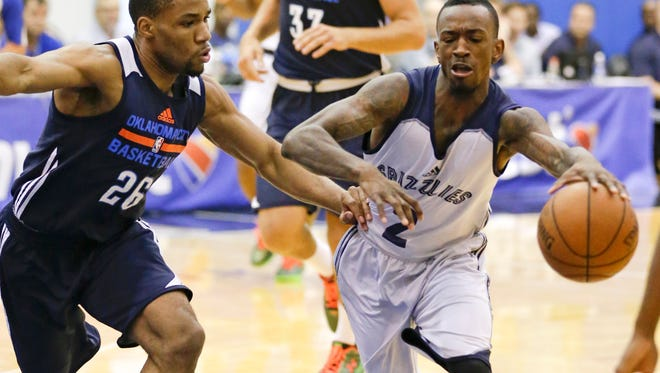 Memphis Grizzlies' Russ Smith (2) drives around Oklahoma City Thunder's Tekele Cotton (26) during the first half of an NBA summer league basketball game, Thursday, July 9, 2015, in Orlando, Fla.