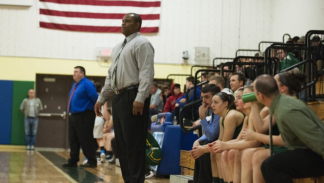 BFA head coach Shawn Earl watches the action on the court during the girls basketball playoff game last week.