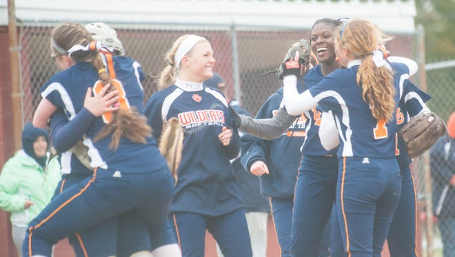 The Delmar softball team celebrates an 8-7 come back win over two-time state champion Laurel at the Laurel Little League Complex on Thursday afternoon.