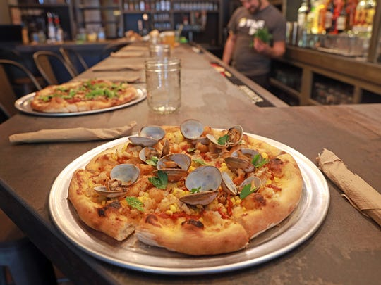 Clam bake pizza is made with roasted corn, dry chorizo,