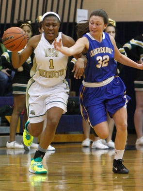 Irondequoit's Mercedes Young, right, is called for the foul as she goes for the steal on Rush-Henrietta's Zana Dillard, left.