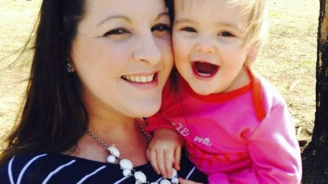 Homicide victim Kimberly McFarland Enix is pictured with her daughter, Brooklynne, in photo taken from Facebook. The 2-year-old girl was recovered safely in Ohio after she was allegedly kidnapped by her father, Tyler Enix, who is charged with the murder of the child's mother. (FACEBOOK)