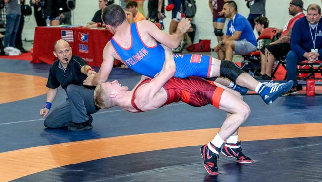 Fowlerville's Dalton Roberts (bottom) qualified for the Greco-Roman world championships in Hungary.