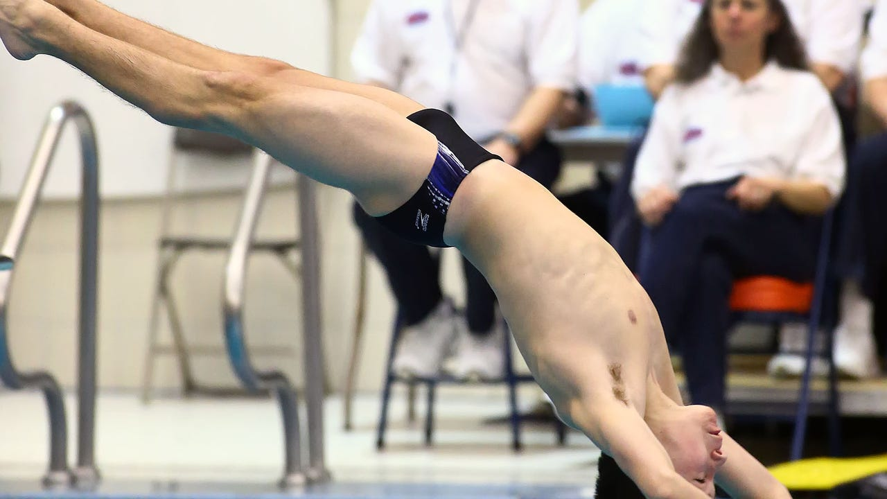 Chambersburg's Nick Cover competes a dive in the Mid