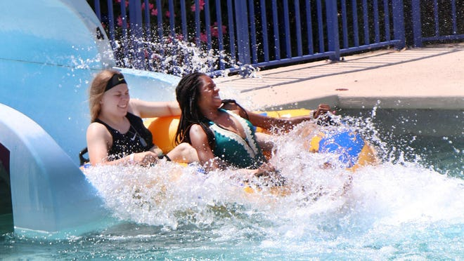 "Visitors splash on the attractions at Daytona Lagoon, where the water park reopened on Friday with new procedures tied to the coronavirus pandemic. ""I feel very confident about what we're doing to keep people safe,"" said Tyler Currie, general manager."